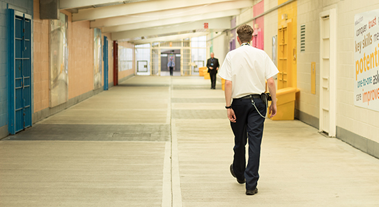 Prison officer walking through prison